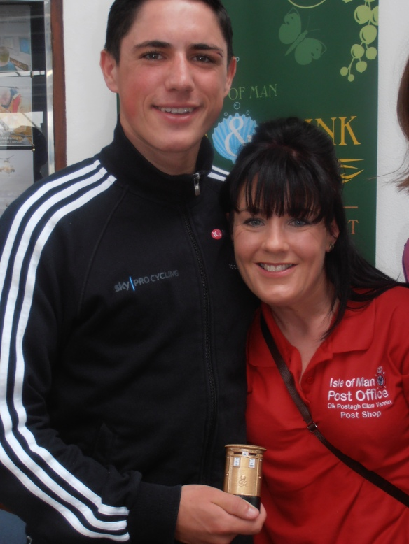 Manx Olympic Gold Medalist Peter Kennaugh and Mirella Annis, marketing assistant, Isle of Man Stamps & Coins